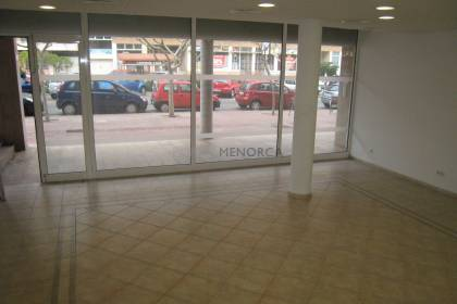 Commercial premises on the ground floor with a large window.