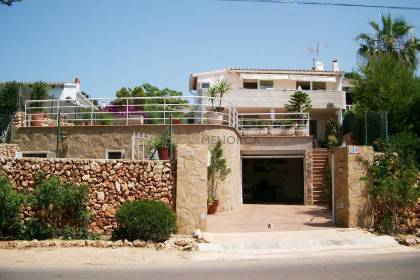 Semi-attached villa with sea view for sale in Binisafua Playa, Sant Lluis