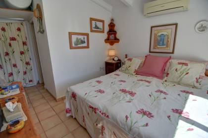 A pretty 2 bedroom villa in Trebaluger, Es Castell.