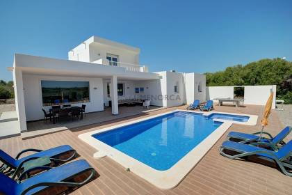 Newly built four bedroom villa with three bathrooms and large swimming pool overlooking open country side.