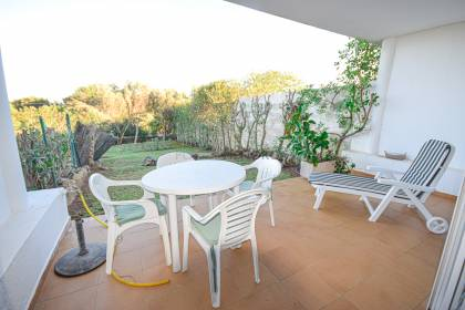 Apartment with large private garden in Arenal d'en Castell.
